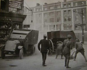 Civil War photo,Free State troops, at the cornor of Henry St and O'Connell St. The blast from the field gun is so powerful it shatters the windows beside the armoured car, note the shards of glass to the left of the photo.