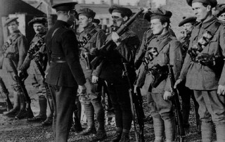 1920, Ireland. An RIC officer inspects members of the Auxiliary's a special force of volunteer British ex-servicemen sent to Ireland to backup the RIC during the war of independents.
