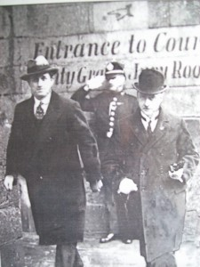 "A very rare photograph. Squad member Charlie Byrne, nicknamed ""The Count"", leaving Green Street Courthouse with W.T.Cosgrave. This photo was given to me by his daughter."