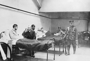 Wounded men in a temp hospital, Dublin Castle. There is a name somewhere on the priest and the guy he is chatting to, but I cant seem to put my hand on it.