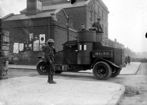 Heres a rare one - it's an armoured car outside Mountjoy Jail. Notice the chalk grafitti on the side of it Up Sinn Féin and note the crowd control in the backround