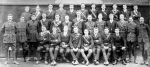 "Officers Training Camp at Volunteers Hall, Sheares Street, Cork commenced Jan 22, 1916. Front Row seated: Cornelius J. Meany, Cornelius Mahoney, Patrick J. Twomey, Martin O'Keefe, Michael Leahy, William Kelliher, James Murphy, Chris McSweeney. Second Row: Sean O'Sullivan, Christopher O'Gorman, Michael Lynch, Sean Lynch, John Manning, Charles Wall, James Walsh, Sean Carroll, Riobard Langford, Maurice Ahern, Tom Hales, Tadgh Barry, Captain J. J. ""Ginger"" O'Connell. Back Row: Paud O'Donoghue, Cornelius Ahern, Sean O'Driscoll, Eugene Walsh, Denis O'Brien, Sean Collins, Seamus Courtney, Jeremiah Mullane, Michael Hyde, Liam O'Brien, Michael McCarthy"