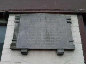 Plaque marking the home of IRA Volunteer Donal Corcoran, Macroom, which was destroyed by the British Army as an 'Official Reprisal' during the War of Independence